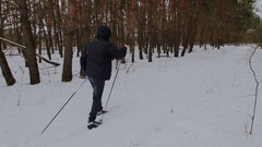 Man cross-country skiing in the woods Stock Footage