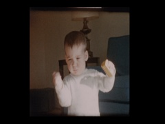 Curious Cute little boy wandering around living room Stock Footage