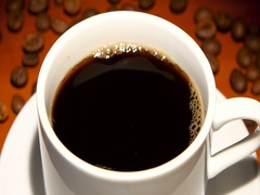 In cup with black coffee falls one piece sugar. Closeup Stock Footage