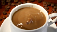 In latte added a lump of sugar and stir, closeup Stock Footage