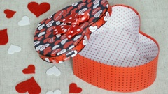 Young woman arrange red heart box with chocolates and pastry Stock Footage