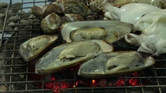 Sea food cooking on a charcoal grill. Stock Footage