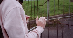 Detail of children hands holding metallic rusty fence. Video in slow motion 4k Stock Footage