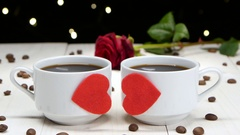 Romance in Valentine's Day. Two cups of coffee for sweethearts Stock Footage