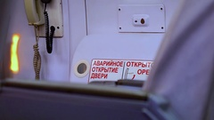 Pointer to emergency exit in passenger compartment of passenger plane Stock Footage