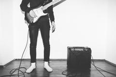 Electric Guitar Playing Teenage Kid with amplifier on White Background Stock Photos