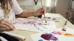 Artist painting in her studio with water colors Stock Footage