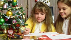 One girl draws a picture in the New Year's Eve, the other prevents it Stock Footage