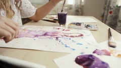 Young woman artist mixing paint while working Stock Footage