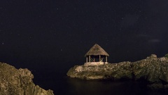 Jamaica: Thatch Hut with Stars and Clouds Stock Footage