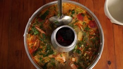 Tom Yum Goong, spicy Thai soup with shrimp in Thai hot pot Stock Footage