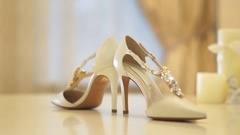 Close-up of a bride shoes on a table Stock Footage