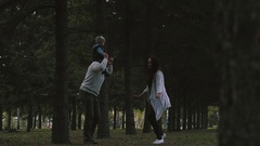 Family with a small child playing in the park Stock Footage