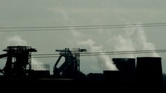 Pollution - smoking chimneys of a factory Stock Footage