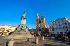 People visit Christmas market at main square in old city Stock Photos