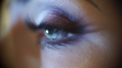 Macro view of a discreet woman with bright makeup, slidecam Stock Footage