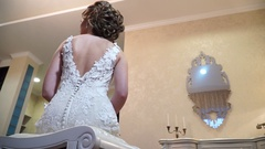 Slow motion, bottom view on the bride's back, slidecam Stock Footage