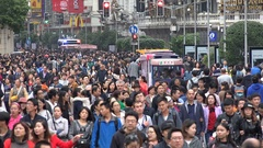 People visit the busy Nanjing shopping street in the weekend in Shanghai, China Stock Footage