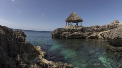 Jamaica: Thatch Hut on Rocky Coast during Day Stock Footage