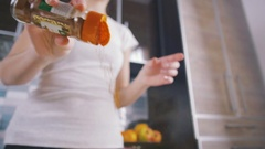 Young woman adding spice in bowl, close up, slow motion Stock Footage