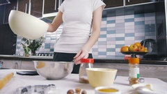 Young woman adding butter in the bowl, close up Stock Footage