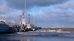 Ice covered pier with ship after storm. Blue sky with white clouds sanctified Stock Footage