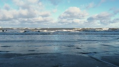 Winter sand beach after a storm. Rolls big waves with foam Stock Footage