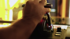 Tug master controls motors. Close-up of hands in a low light Stock Footage