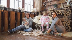 Happy family sitting on the floor near the fireplace Stock Footage