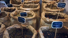 Large bags of black, green, fruit and other tea on the market Stock Footage