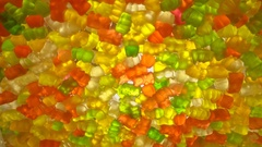 Round, tasty, glossy, multicolored, translucent appealing candied fruit jelly Stock Footage