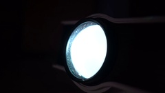 Home portable film projector macro shot, closeup. Turn on and turn off Stock Footage