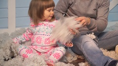 Close-up of a father with his little daughter rush artificial snow Stock Footage