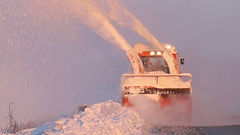 Snow truck cleaning snow from the road and streets working in snowy day Stock Footage
