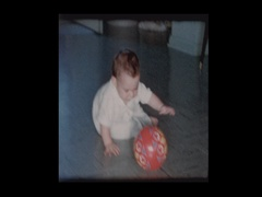 Happy baby boy crawling around slippery tile floor Stock Footage