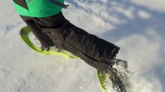 Gorgeous slow motion of little boy snowshoeing on a wonderful snowy winter day. Stock Footage