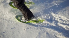 Beautiful top shot of little boy snowshoeing on a wonderful snowy winter day. Stock Footage