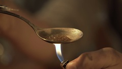 Dangerous liquid narcotic substance prepared in spoon, drug dependence problem Stock Footage