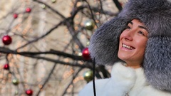 Happy young woman in gray fur head cloth outdoor in winter Stock Footage