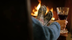 Person Enjoy your stay near the fireplace, holding a glass of wine in hand. Back Stock Footage