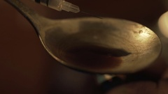 Close-up of liquid drug dose boiling in spoon, syringe needle prepared for shoot Stock Footage