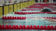 Sport swimming turn at a distance Stock Footage