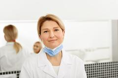 Smiling doctor after finishing her work Stock Photos