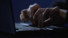 Male criminal inserting password on laptop, illegal unauthorized access attempt Stock Footage