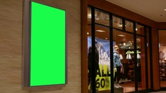 Green billboard for your ad on wall inside Coquitlam shopping mall Stock Footage