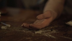 Hand of male opiate addict under influence falling on table, drug abuse problem Stock Footage