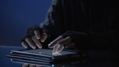 Man illegally viewing confidential files on tablet, secret information leakage Stock Footage