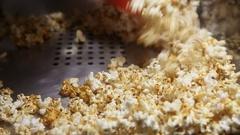 Shovel gaining microwave popcorn Stock Footage