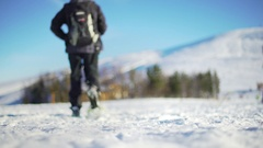 Man snowshoeing walking away from camera on a wonderful snowy winter day. Stock Footage