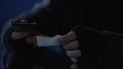 Thief inserting pincode for unauthorized access to bank account via mobile app Stock Footage